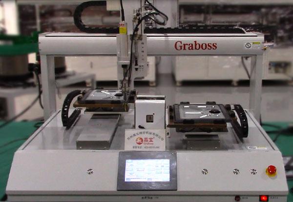 上海某有限公司桌面螺丝机锁苹果配件自动螺丝机设备案例