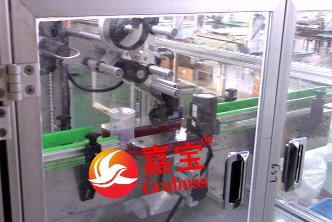 落地式塑料瓶盖自动拧紧与标签贴附设备 -自动贴标图